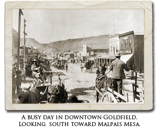 A busy day in downtown Goldfield. Looking south toward Malpais Mesa.