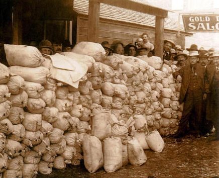 Constable Claude Inman (with badge) stands by stolen gold ore.